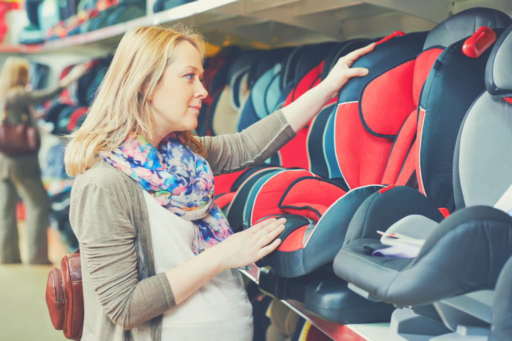 Pregnant mother shops for baby car seat