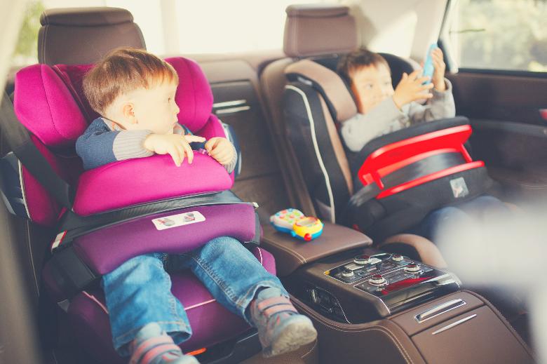 2 kids in luxury baby car seats