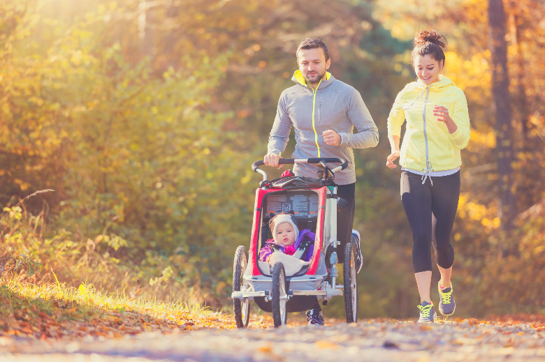 Parents running with baby in stroller