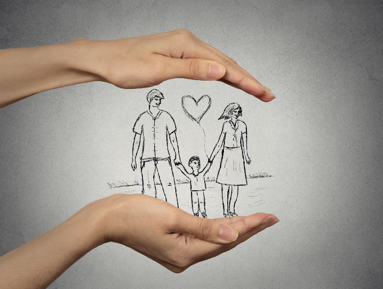 woman's hands framing picture of happy, safe family