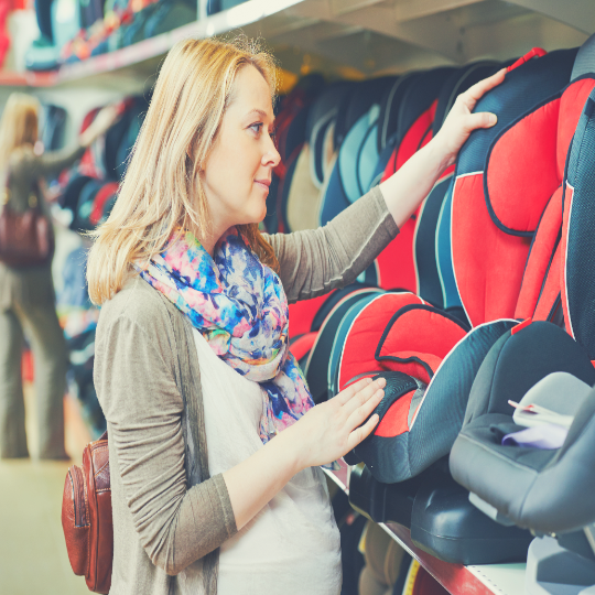 Mother shopping for baby car seat