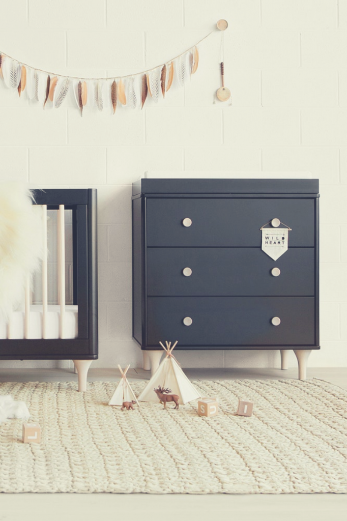 Black dual-function changer dresser for baby's bedroom