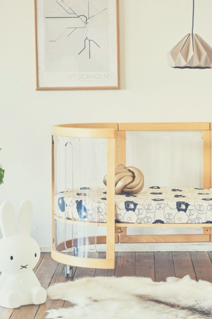 Baby's room with stylish cot and bedding