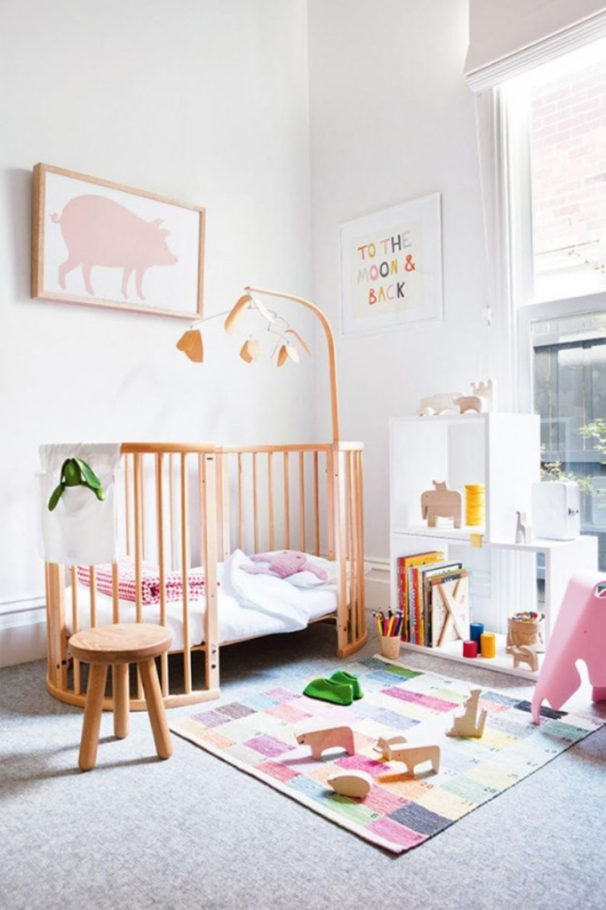 Stylish baby nursery with a statement rug